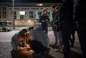 epa05023962 People light candles in tribute to the victims of the Paris attacks, outside the French embassy in Berlin, Germany, 13 November 2015. Dozens of people have been killed in a series of attacks in Paris on 13 November. EPA/LUKAS SCHULZE